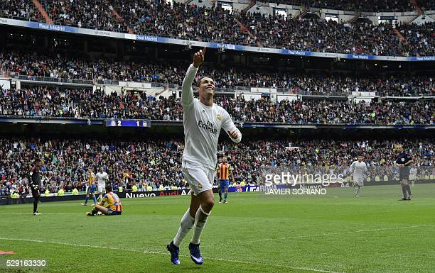 Real Madrid's Portuguese forward Cristiano Ronaldo celebrates after scoring a goal during the Spanish league football match Real Madrid CF vs...