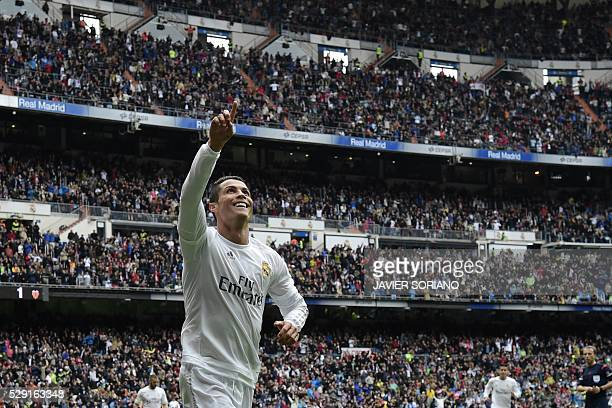 TOPSHOT Real Madrid's Portuguese forward Cristiano Ronaldo celebrates after scoring a goal during the Spanish league football match Real Madrid CF vs...