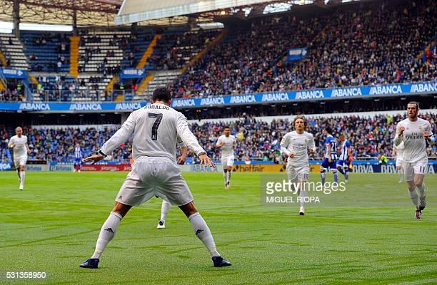 TOPSHOT Real Madrid's Portuguese forward Cristiano Ronaldo celebrates after scoring a goal during the Spanish league football match RC Deportivo de...