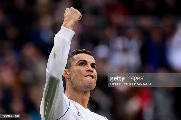 Real Madrid's Portuguese forward Cristiano Ronaldo celebrates after scoring a penalty during the Spanish league football match between Real Madrid...