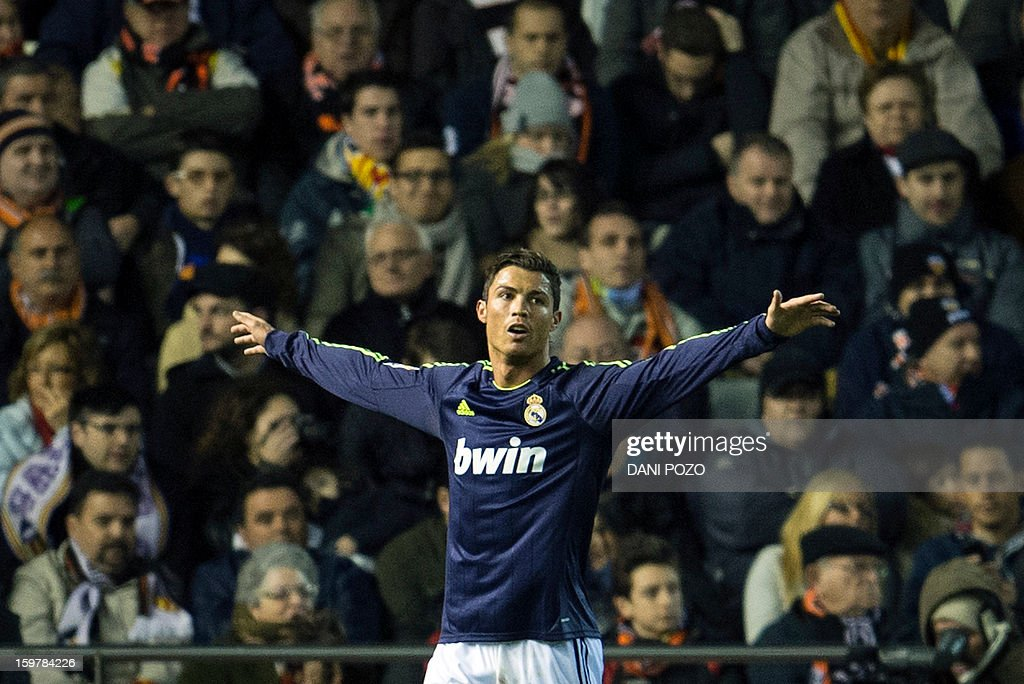 Real Madrid's Portuguese forward Cristiano Ronaldo celebrates after scoring during the Spanish first league football match Valencia CF vs Real Madrid on January 20, 2013 at the Mestalla stadium in Valencia.