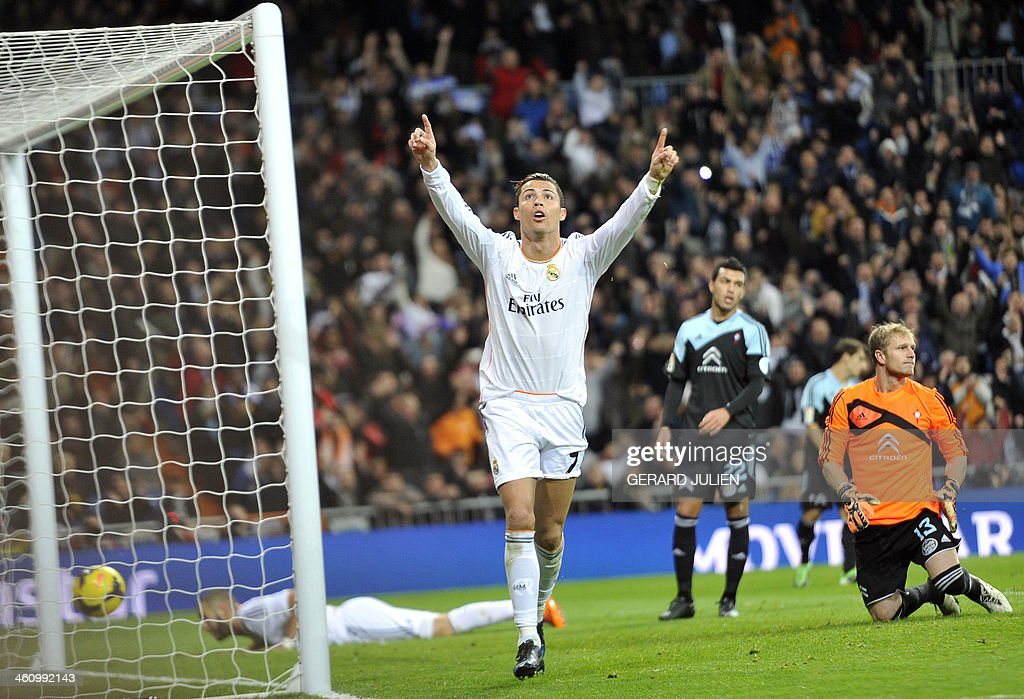 Real Madrid's Portuguese forward Cristiano Ronaldo (C) celebrates after scoring during the Spanish league football match Real Madrid vs RC Celta de Vigo at the Santiago Bernabeu stadium in Madrid on January 6, 2014.