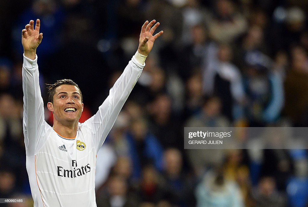Real Madrid's Portuguese forward Cristiano Ronaldo celebrates after scoring his second goal during the Spanish league football match Real Madrid vs RC Celta de Vigo at the Santiago Bernabeu stadium in Madrid on January 6, 2014. Real Madrid won 3-0.