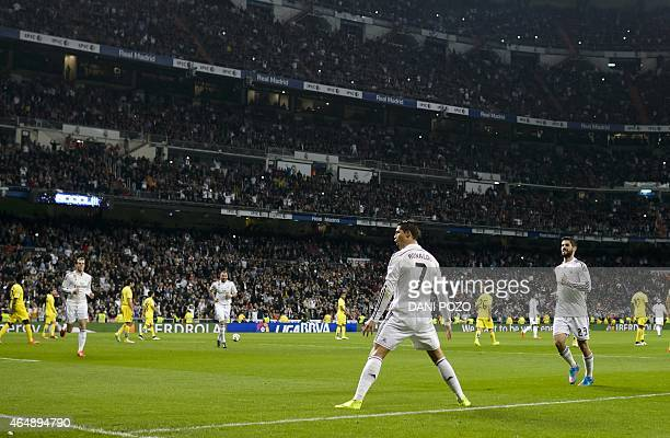 Real Madrid's Portuguese forward Cristiano Ronaldo celebrates after scoring on a penalty kick during the Spanish league football match Real Madrid CF...