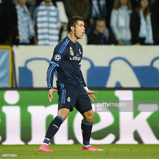 Real Madrid's Portuguese forward Cristiano Ronaldo celebrates after scoring the opening goal during the UEFA Champions League firstleg Group A...