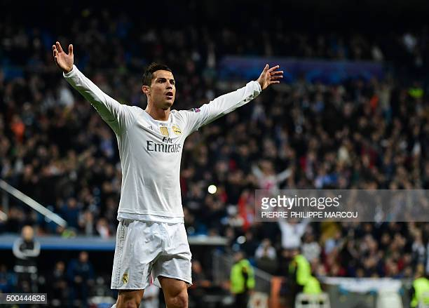 Real Madrid's Portuguese forward Cristiano Ronaldo celebrates after scoring during the UEFA Champions League Group A football match Real Madrid CF vs...