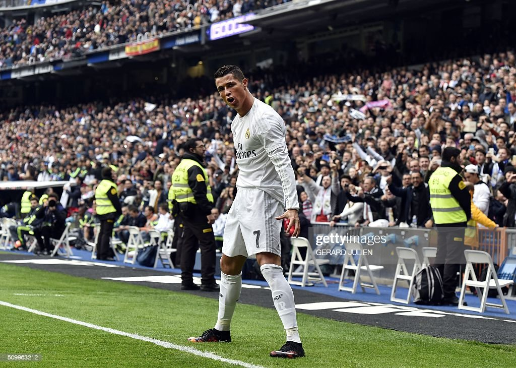 Real Madrid's Portuguese forward Cristiano Ronaldo celebrates after scoring during the Spanish league football match Real Madrid CF vs Athletic Club Bilbao at the Santiago Bernabeu stadium in Madrid on February 13, 2016. / AFP / GERARD JULIEN