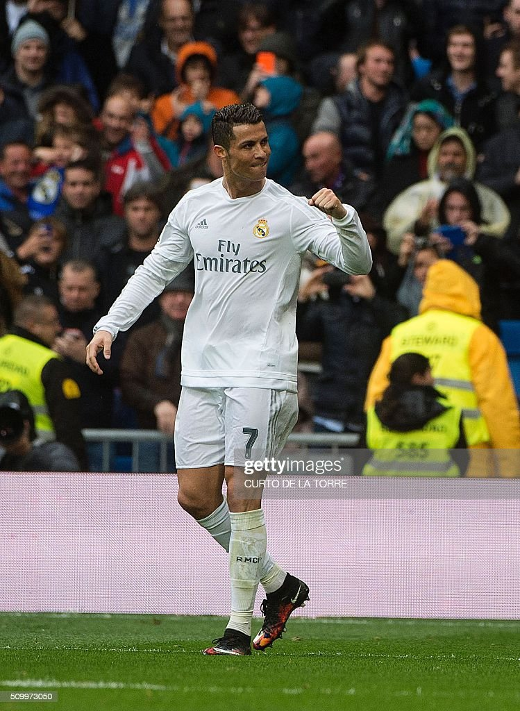 Real Madrid's Portuguese forward Cristiano Ronaldo celebrates after scoring during the Spanish league football match Real Madrid CF vs Athletic Club Bilbao at the Santiago Bernabeu stadium in Madrid on February 13, 2016. / AFP / CURTO DE LA TORRE