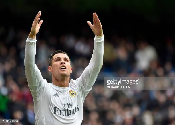 Real Madrid's Portuguese forward Cristiano Ronaldo celebrates after making it a hat trick by scoring his third goal during the Spanish league...