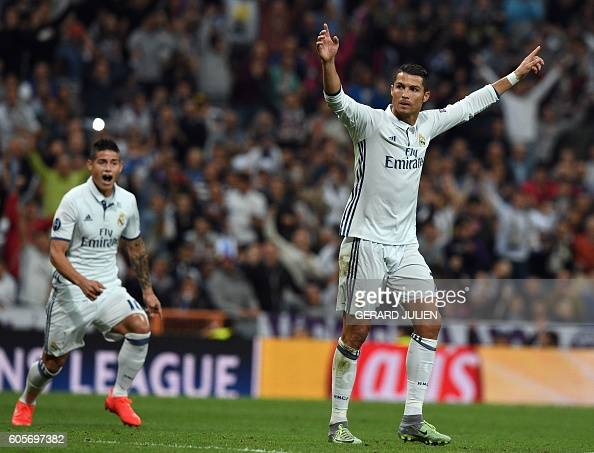 Real Madrid's Portuguese forward Cristiano Ronaldo celebrates after scoring during the UEFA Champions League football match Real Madrid CF vs...