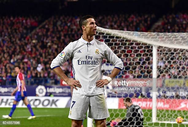 Real Madrid's Portuguese forward Cristiano Ronaldo celebrates after scoring his third goal during the Spanish league football match Club Atletico de...