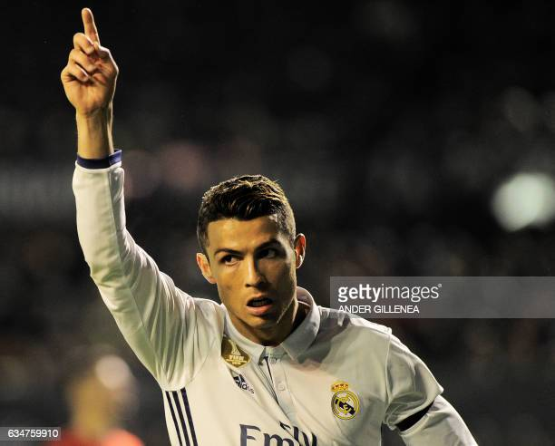 Real Madrid's Portuguese forward Cristiano Ronaldo celebrates after scoring his team's first goal during the Spanish league football match CA Osasuna...