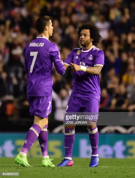 Real Madrid's Portuguese forward Cristiano Ronaldo celebrates after scoring with Real Madrid's Brazilian defender Marcelo during the Spanish league...