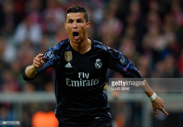 Real Madrid's Portuguese forward Cristiano Ronaldo celebrates after scoring during the UEFA Champions League 1st leg quarterfinal football match FC...