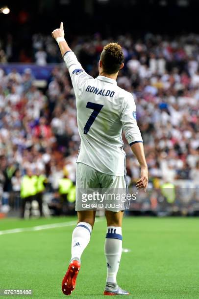 Real Madrid's Portuguese forward Cristiano Ronaldo celebrates after scoring during the UEFA Champions League semifinal first leg football match Real...