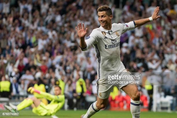 TOPSHOT Real Madrid's Portuguese forward Cristiano Ronaldo celebrates after scoring his second goal during the UEFA Champions League semifinal first...