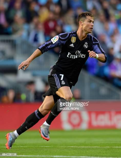 Real Madrid's Portuguese forward Cristiano Ronaldo celebrates after scoring the opener during the Spanish league football match RC Celta de Vigo vs...