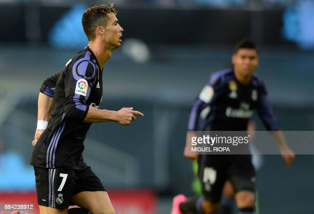 Real Madrid's Portuguese forward Cristiano Ronaldo celebrates after scoring the opener during the Spanish league football match RC Celta de Vigo vs...