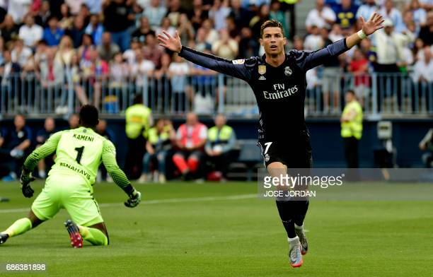 TOPSHOT Real Madrid's Portuguese forward Cristiano Ronaldo celebrates after scoring during the Spanish league football match Malaga CF vs Real Madrid...