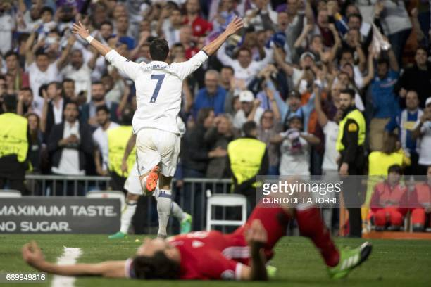 TOPSHOT Real Madrid's Portuguese forward Cristiano Ronaldo celebrates during the UEFA Champions League quarterfinal second leg football match Real...