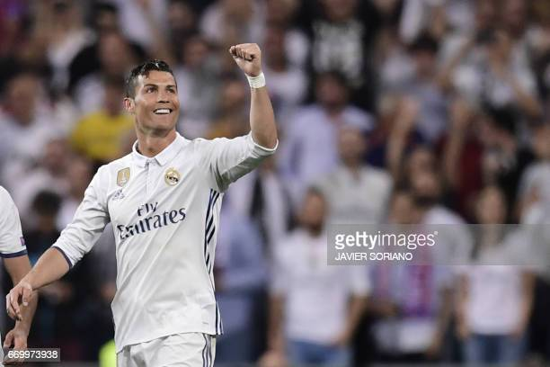 Real Madrid's Portuguese forward Cristiano Ronaldo celebrates during the UEFA Champions League quarterfinal second leg football match Real Madrid vs...