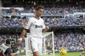 Real Madrid's Portuguese forward Cristiano Ronaldo celebrates his first goal on September 2 2012 during a Spanish Liga football match against Granada...