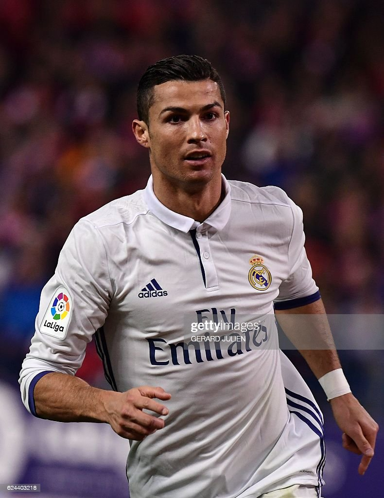 Real Madrid's Portuguese forward Cristiano Ronaldo celebrates his third goal during the Spanish league football match between Club Atletico de Madrid and Real Madrid CF at the Vicente Calderon stadium in Madrid, on November 19, 2016.. / AFP / GERARD