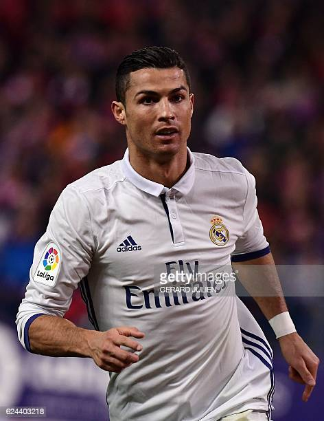 Real Madrid's Portuguese forward Cristiano Ronaldo celebrates his third goal during the Spanish league football match between Club Atletico de Madrid...
