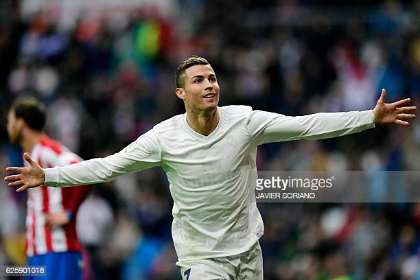 TOPSHOT Real Madrid's Portuguese forward Cristiano Ronaldo celebrates his second goal during the Spanish league football match Real Madrid CF vs Real...