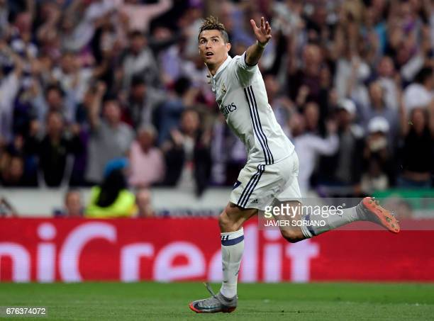 Real Madrid's Portuguese forward Cristiano Ronaldo celebrates his second goal during the UEFA Champions League semifinal first leg football match...
