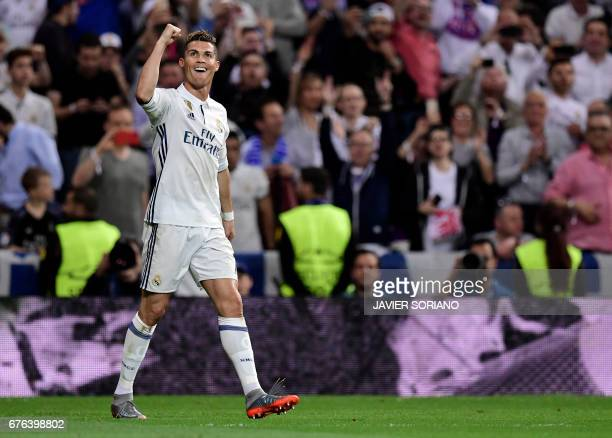 Real Madrid's Portuguese forward Cristiano Ronaldo celebrates his third goal during the UEFA Champions League semifinal first leg football match Real...
