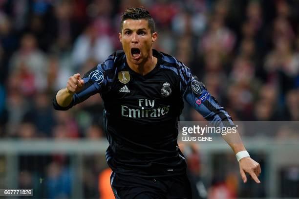 TOPSHOT Real Madrid's Portuguese forward Cristiano Ronaldo celebrates scoring the 11 during the UEFA Champions League 1st leg quarterfinal football...