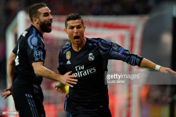 Real Madrid's Portuguese forward Cristiano Ronaldo celebrates scoring the 11 goal with Real Madrid's defender Dani Carvajal during the UEFA Champions...