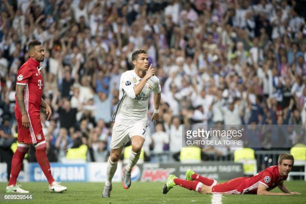 Real Madrid's Portuguese forward Cristiano Ronaldo celebrates scoring during the UEFA Champions League quarterfinal second leg football match Real...
