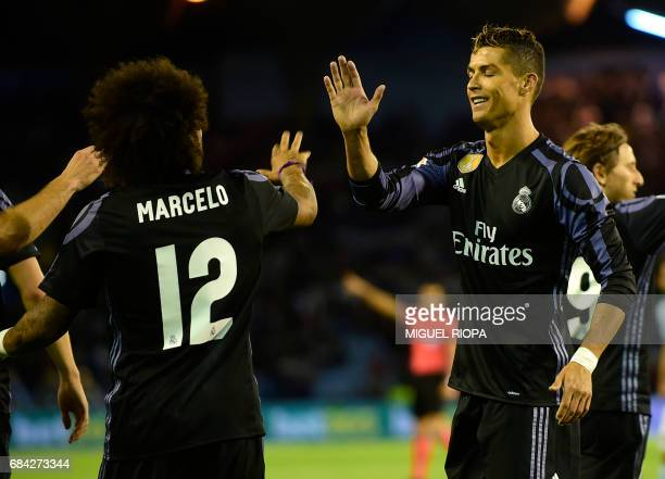 Real Madrid's Portuguese forward Cristiano Ronaldo celebrates their third goal with Real Madrid's Brazilian defender Marcelo during the Spanish...
