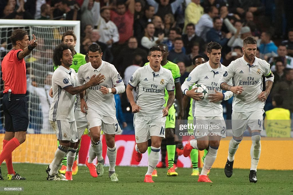 Real Madrid's Portuguese forward Cristiano Ronaldo (2ndL) celebrates with his teammates after scoring during the UEFA Champions League football match Real Madrid CF vs Sporting CP at the Santiago Bernabeu stadium in Madrid on September 14, 2016. Real Madrid won 2-1. / AFP / CURTO