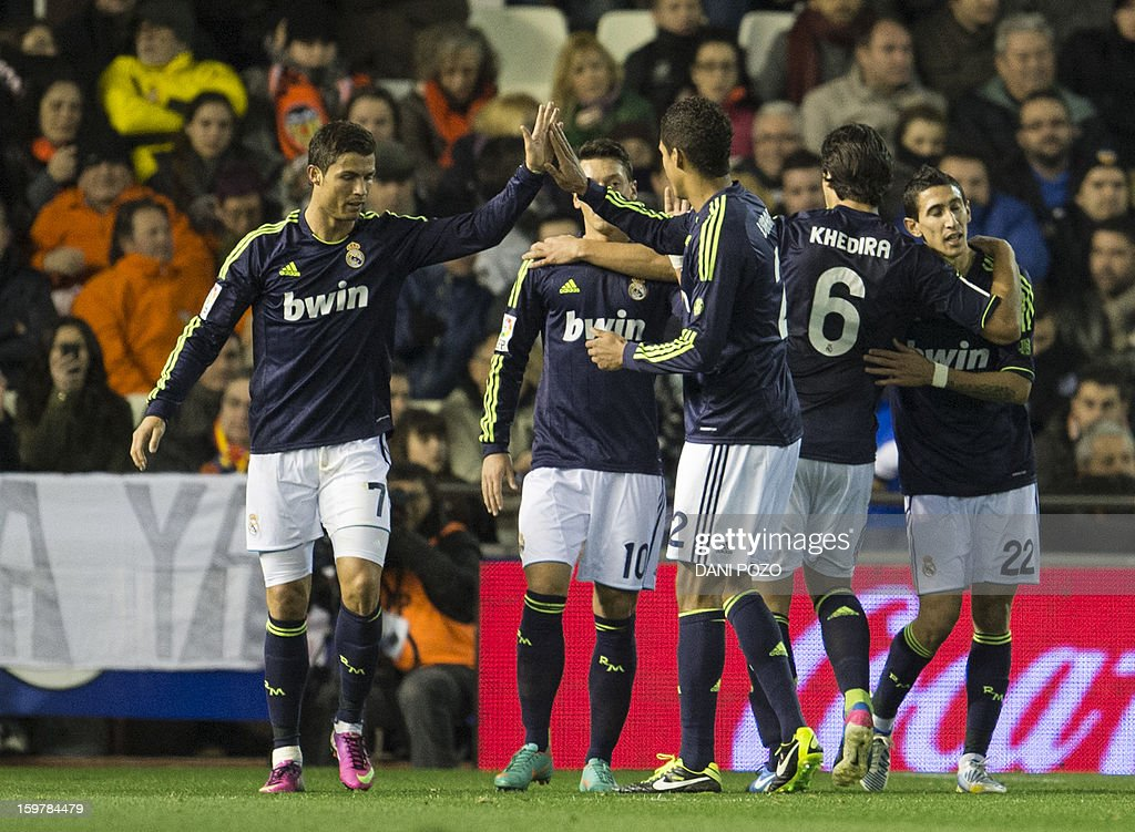 Real Madrid's Portuguese forward Cristiano Ronaldo celebrates with teammates after scoring during the Spanish first league football match Valencia CF vs Real Madrid on January 20, 2013 at the Mestalla stadium in Valencia.