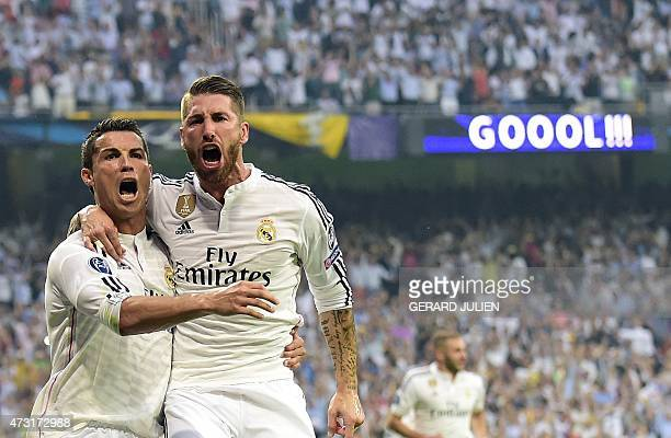 Real Madrid's Portuguese forward Cristiano Ronaldo celebrates with Real Madrid's defender Sergio Ramos after scoring during the UEFA Champions League...