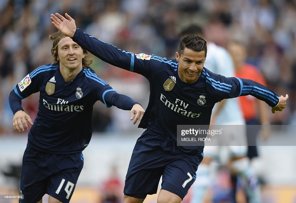 Real Madrid's Portuguese forward Cristiano Ronaldo celebrates with teammate Croatian midfielder Luka Modric after scoring a goal during the Spanish...
