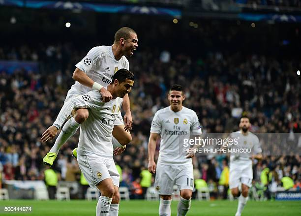 Real Madrid's Portuguese forward Cristiano Ronaldo celebrates with Real Madrid's Portuguese defender Pepe after scoring during the UEFA Champions...