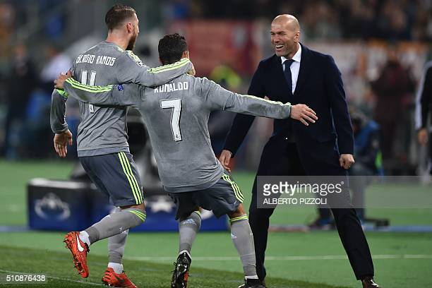Real Madrid's Portuguese forward Cristiano Ronaldo celebrates with Real Madrid's defender Sergio Ramos and Real Madrid's French coach Zinedine Zidane...