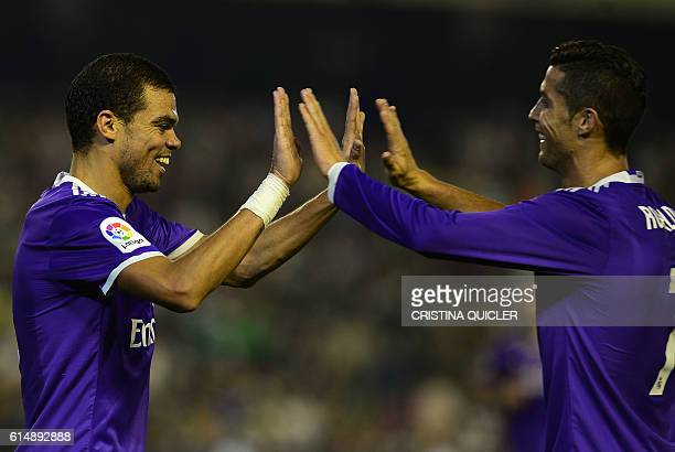 Real Madrid's Portuguese forward Cristiano Ronaldo celebrates with Real Madrid's Portuguese defender Pepe after Real Madrid's midfielder Isco scored...