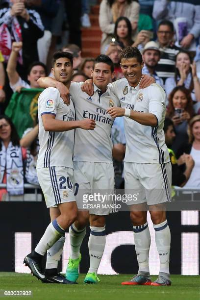 Real Madrid's Portuguese forward Cristiano Ronaldo celebrates with Real Madrid's Colombian midfielder James Rodriguez and Real Madrid's midfielder...