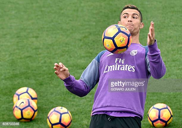 Real Madrid's Portuguese forward Cristiano Ronaldo controls a ball during a training session at Valdebebas training ground in Madrid on December 9 on...