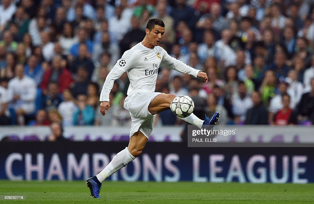 Real Madrid's Portuguese forward Cristiano Ronaldo controls a ball during the UEFA Champions League semi-final second leg football match Real Madrid CF vs Manchester City FC at the Santiago Bernabeu stadium in Madrid, on May 4, 2016. / AFP / PAUL
