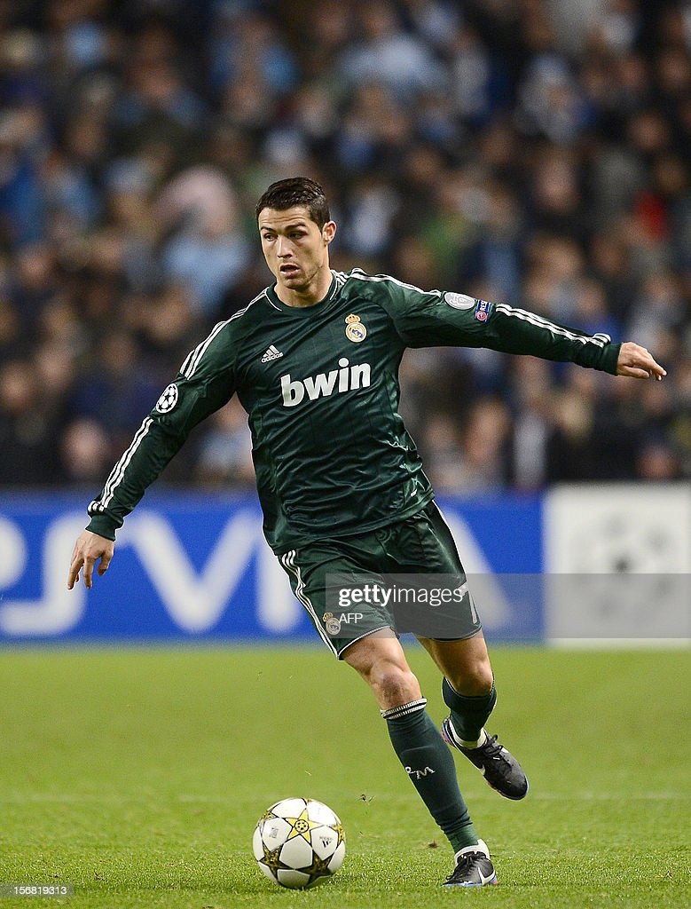 Real Madrid's Portuguese forward Cristiano Ronaldo controls the ball during the UEFA Champions League Group D football match between Manchester City and Real Madrid at the Etihad Stadium in Manchester, North-west England, on November 21, 2012. AFP PHOTO/ PIERRE-PHILIPPE MARCOU