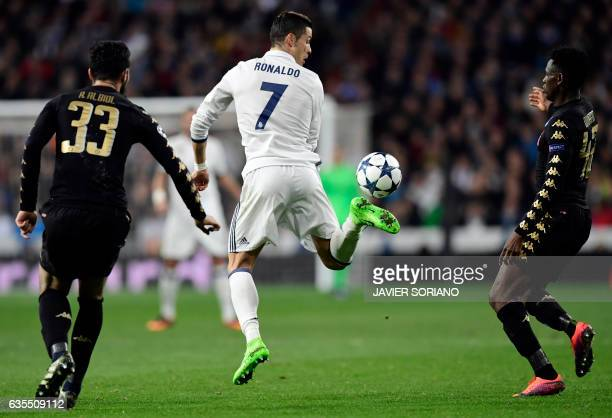 TOPSHOT Real Madrid's Portuguese forward Cristiano Ronaldo controls the ball during the UEFA Champions League round of 16 first leg football match...