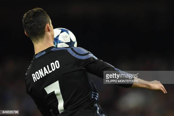 Real Madrid's Portuguese forward Cristiano Ronaldo controls the ball during the UEFA Champions League football match SSC Napoli vs Real Madrid on...