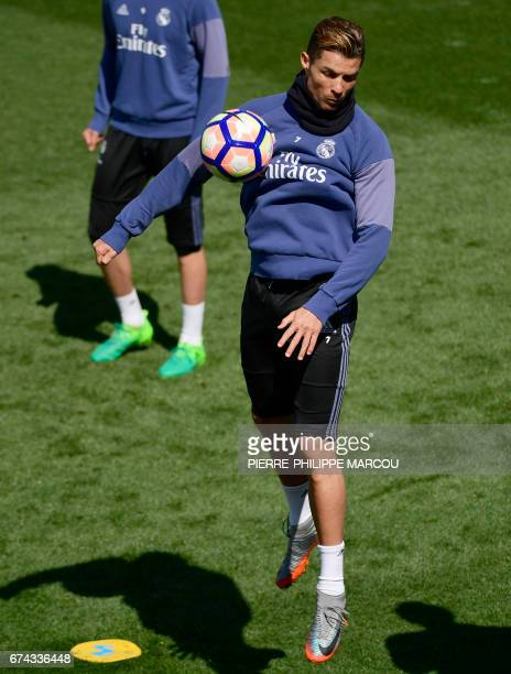 Real Madrid's Portuguese forward Cristiano Ronaldo controls the ball during a training session at Valdebebas Sport City in Madrid on April 28 2017 on...