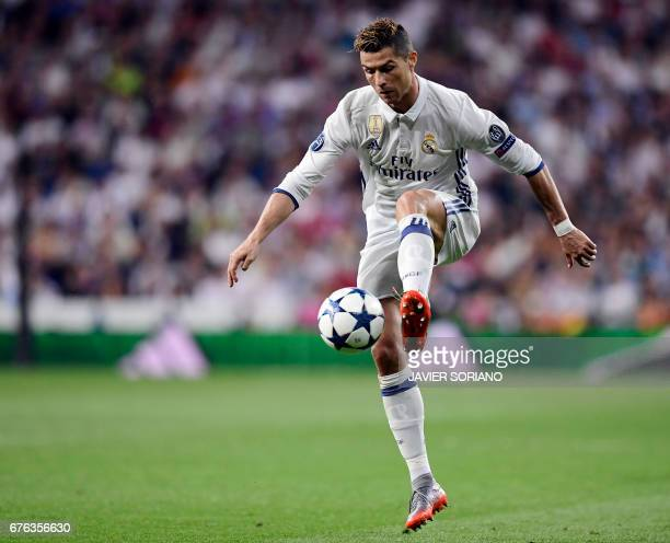 Real Madrid's Portuguese forward Cristiano Ronaldo controls the ball during the UEFA Champions League semifinal first leg football match Real Madrid...
